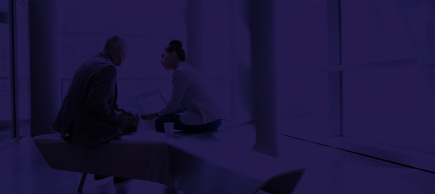 Background image of man and woman discussing business